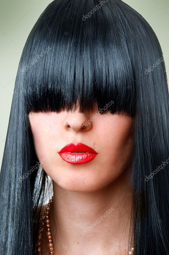 Closeup portrait of beautiful fashion woman with seductive red lips and creative black hairstyle with bang covering her eyes — Photo #4822107