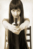 Beautiful brunette woman with handgun — Stock Photo