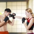 Couple fight. Woman fighter punching man — Stock Photo