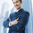 Handsome successful business man smiling outdoor — Stock Photo