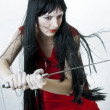 Sexual woman fighter with medieval sword — Stock Photo #5062011
