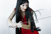 Sexual woman fighter with medieval sword — Stock Photo