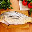 Fresh fish (carp) with vegetables — Stock Photo