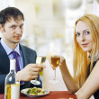 Couple at restaurant on dinner party - Stock Photo
