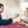 Young loving couple in restaurant. — Stock Photo