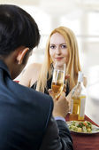 Couple at restaurant dining and toasting. — Stock Photo