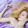 Royalty-Free Stock Photo: Young beautiful woman sleeping in bed