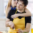 Stock Photo: Young loving couple embracing face to face in kitchen