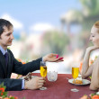 Young man propose marriage to woman in restaurant. — Stock Photo