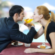 Young happy amorous couple drink with white wine — 图库照片