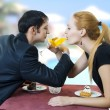 Stock Photo: Young happy amorous couple drink with white wine