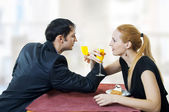 Young amorous couple celebrating at restaurant. — Stock Photo