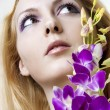Beauty woman face and flowers closeup — Stock Photo
