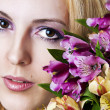 Stock Photo: Female face with perfect skin and flowers