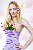 Portrait of beautiful woman with spring flowers — Stock Photo