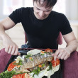 Hungry young man waiting to eat — Stock Photo
