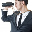 Young business man looking through binoculars — Stock Photo