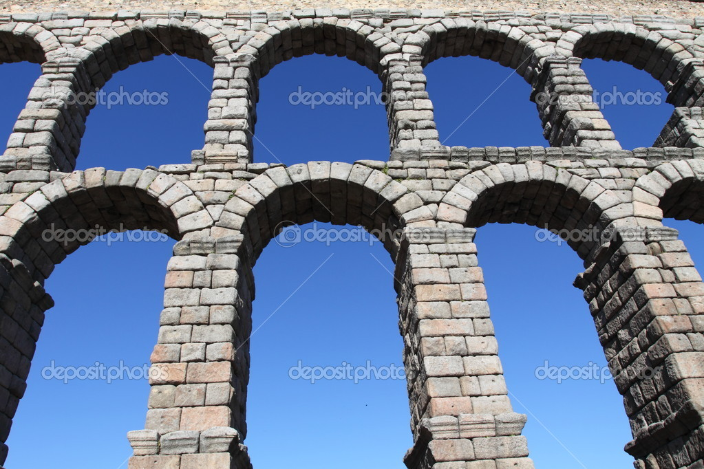 The famous Roman Aqueduct in Segovia in Spain.  Stock Photo #5238384