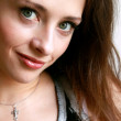 Macro portrait of beautiful girl with green eyes — Stock Photo #4098010