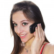 Royalty-Free Stock Photo: Beautiful smiling girl talking on mobile phone isolated over