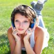 Young girl listens to music - Stock Photo