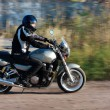 Man riding a motorcycle on the road - Foto Stock