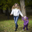 Stock Photo: Mother and Daughter in Autumn Park