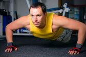 Man training in fitness center — Stock Photo