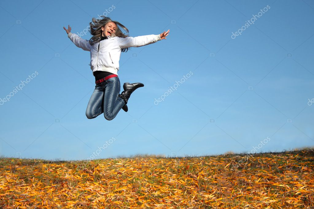 Joyful Woman jumping  Stock Photo #5036118
