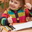 Little girl drawing with pencils at home — Stock Photo #5116505