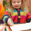 Little girl drawing with pencils at home — Stock Photo