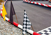 Flags on carting track — Stock Photo