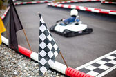 Flags and car on carting track — Stock Photo
