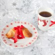 Brioche tied with a red bow on a plate in Christmas style — Stock Photo