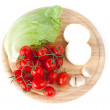 Mozzarella, tomatoes, garlic and salad leaf and basil on wooden board — Stock Photo