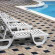 Deckchair by the pool — Stock Photo