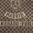 Manhole cover in Madrid — Stok fotoğraf