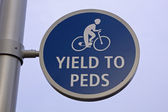 Yield to peds — Stock Photo