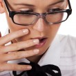 Girl with glasses covers mouth with his hand — Stock Photo #4831099