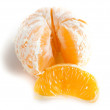 Peeled tangerine on white background — Stock Photo