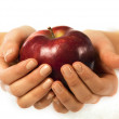 Stock Photo: Fresh red apple in womhand