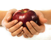 Fresh red apple in a woman hand — Stock Photo