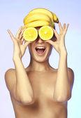 Portrait of topless beautiful woman, she holding orange slice — Stock Photo