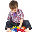 Little boy playing with inflatable balls colored — Stock Photo