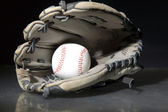 Baseball game sports equipment on reflecting surface — Stock Photo