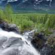 Stock Photo: View from above waterfall on forest and far away mountains
