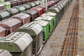 Range of multicoloured rail road waggons — Stock Photo