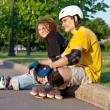 Young couple put on inline skates — Stock Photo #4905668