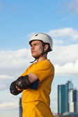Young man in helmet and protective gear — Stock Photo