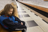 Homeless madman on the bench — Stock Photo